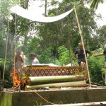 Cremation ceremony in Lombok, bed set on fire